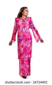 happy asian malay woman in traditional dress having fun