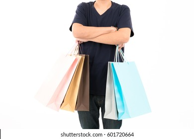 Happy Asian male shopper isolated on white background. For shopping, consumer, sale, business, young man, season shopper, colourful shopping bag, spring sale, summer sale, winter sale.