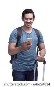 Happy asian male traveler with bags and mobile phone isolated over white background