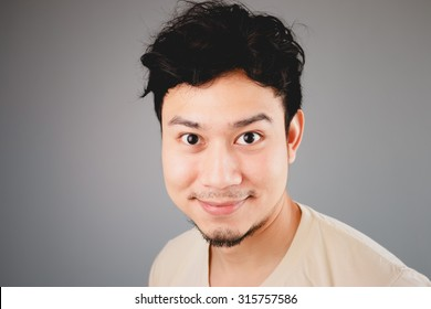 Happy Asian man close up portrait.