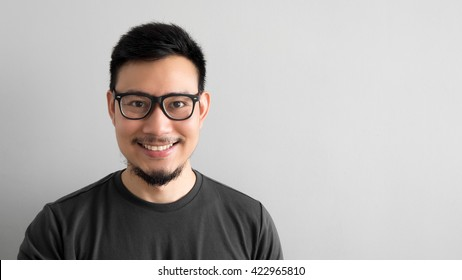 Happy Asian man with eyeglasses.