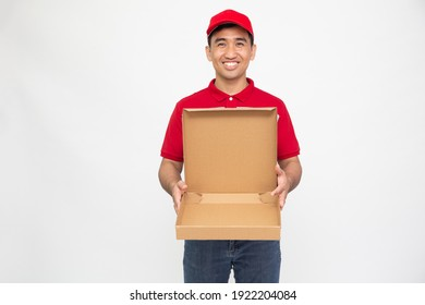 Happy Asian man in red t-shirt and cap holding empty pizza box isolated over white background, Delivery food service concept