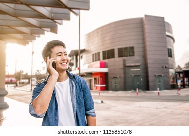 Happy asian man using smart phone on the corner of road, Smiling man using mobile phone on the street