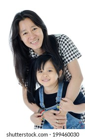 Happy  asian mother and daughter smiling - isolated over a white background