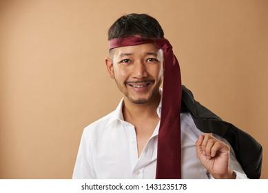 Happy asian office worker with tie on head portrait
