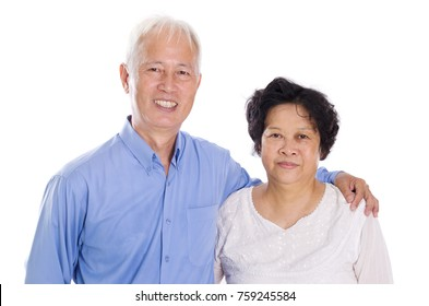 Happy Asian old couple smiling,  standing isolated on white background.