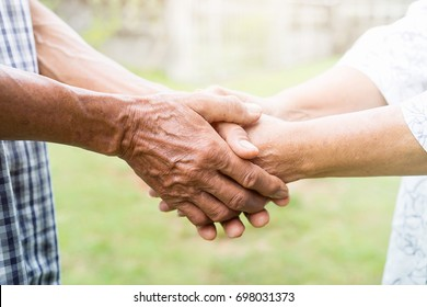 Happy asian older, Elderly couples are holding hands, Concept of take care mature together.