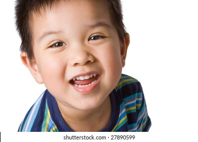Happy Asian preschool-aged boy, smiling. Isolated on white.