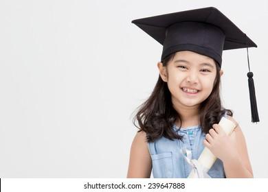 Happy Asian school kid graduate in graduation cap