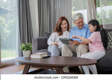 Happy Asian Senior Couple  lifestyle and family,Grandparents with her granddaughte using tablet