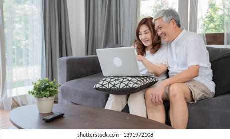 Happy Asian Senior Couple  lifestyle technology device concept,Lovely elderly couple using laptop computer