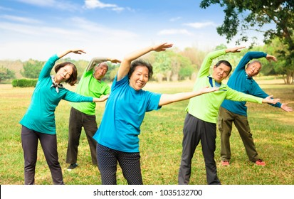 happy asian Senior Group Friends Exercise and   having fun