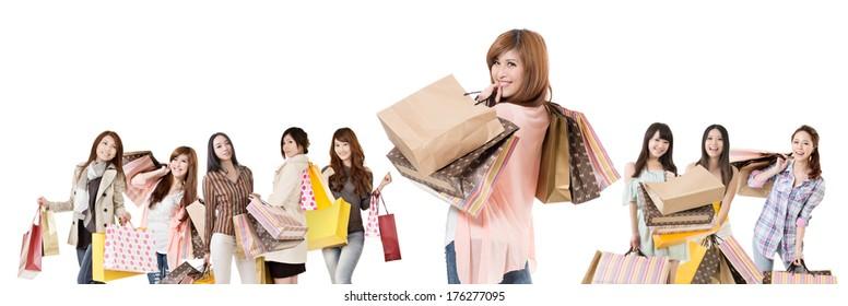 Happy Asian shopping girls on white background.