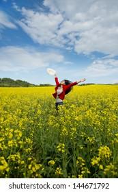 happy asian woman in a canola field
