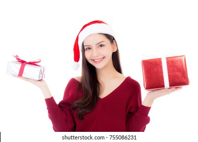 Happy asian woman with smile holding gift box of xmas, Present girl with celebration christmas a holiday, girl with buyer isolated on white background, shopping with season concept.