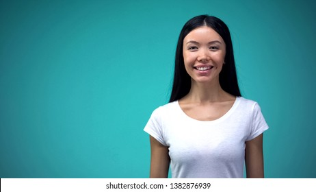 Happy asian woman smiling and looking at camera, perfect skin hair and teeth