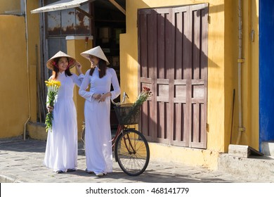 Happy asian women with Vietnam culture traditional dress, Ao dai is famous traditional costume, vintage style, Hoi an Vietnam
