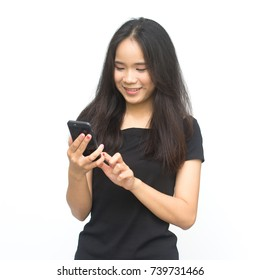 Happy asian young girl holding and using smart phone isolated on white background