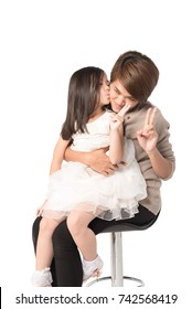 Happy asian young mother hugging cute daughter are kissing her mom and sitting on chair, Isolated on white .Childhood, parenting lover and relationship concept