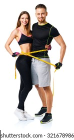 Happy athletic couple - man and woman with measuring tape on the white background