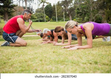 Happy athletic group training on a sunny day