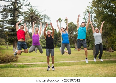 Happy athletic jumping together on a sunny day