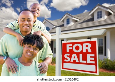 Happy and Attractive African American Family with For Sale Real Estate Sign and House.
