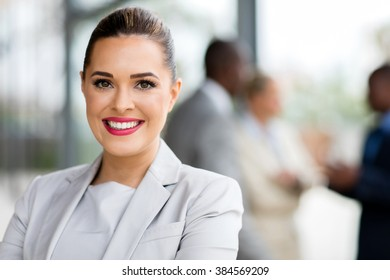 happy attractive businesswoman in office