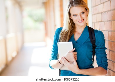 happy attractive female university student with tablet computer on campus