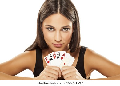 Happy attractive girl holding the winning combination of poker cards