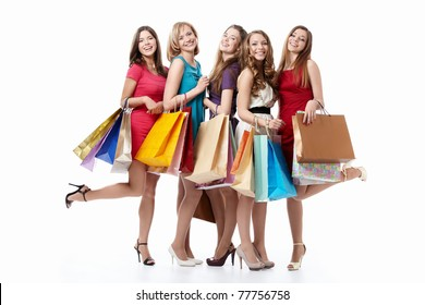 Happy attractive girl with shopping on white background