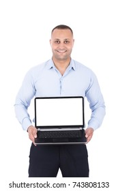 Happy attractive man showing an advertisement on his laptop screen. Isolated on white background.