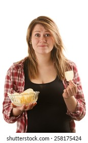 Happy, attractive woman holding a bowl of potato chips