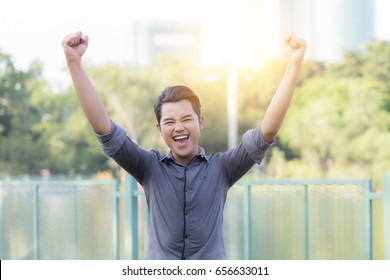 Happy Attractive young business man celebrating after him work finished feeling so happiness and cheerful,Business Success Concept