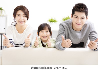 Happy Attractive Young  Family with thumbs up