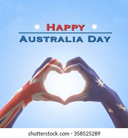 Happy Australia Day: flag pattern on people hands in heart shape