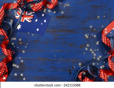 Happy Australia Day, January 26, theme dark blue vintage distressed wood background with Australian flag and decorations with copy space for your text here.