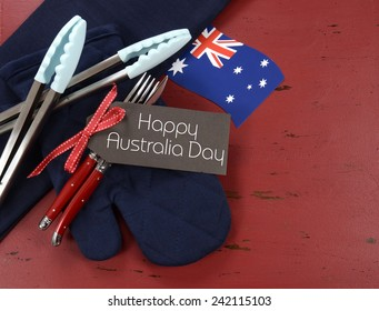 Happy Australia Day, January 26, theme red, white and blue barbeque setting on dark red vintage wood background.