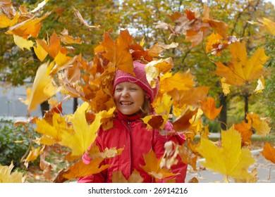 happy autumn. Girl flip leaves