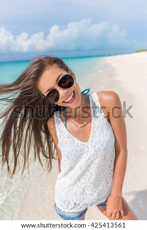 02324d0a758 Happy aviator sunglasses woman beach fun playful with healthy hair.  Beautiful young Asian model posing smiling at camera enjoying summer  holidays on ...