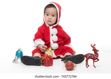 Happy baby attire Santa Claus clothes on the white background.
