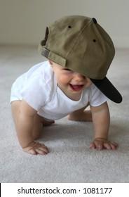 happy baby in a baseball cap