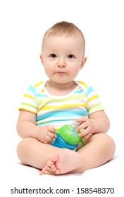 happy baby boy holding milk bottle