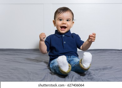 Happy baby boy in jeans and polo t-shirt