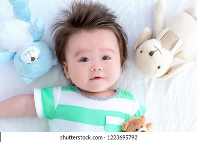Happy baby boy lying down and resting