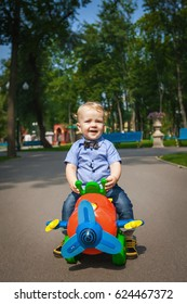 happy baby driving toy car outdoors