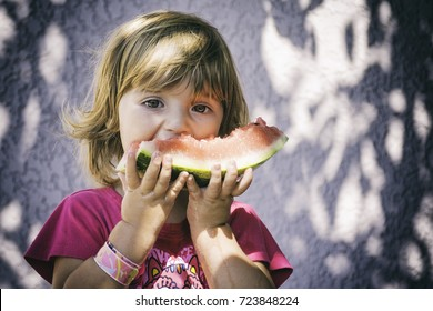 Happy baby eating watermelon