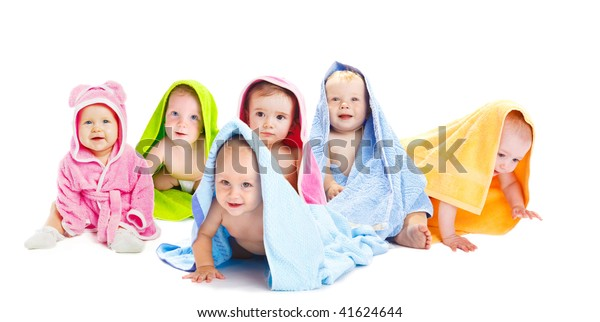 Happy baby friends in bath towels