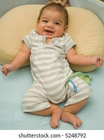 Happy baby giggling