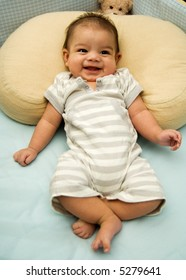 Happy baby giggling in his crib